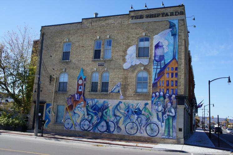 collingwood mural on side of building done by john and